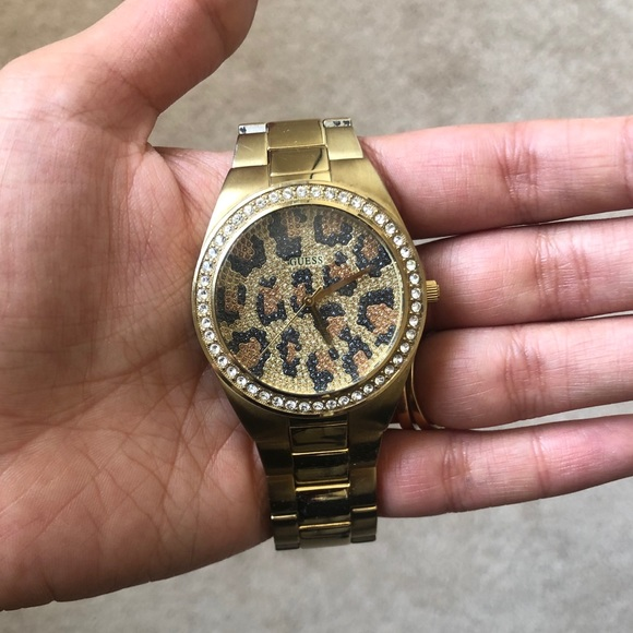 Gold Guess watch with leopard background